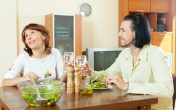 Couple having dinner at the house of green vegetables Stock Photography