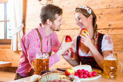 Couple having dinner at mountain hut in alps Royalty Free Stock Photo