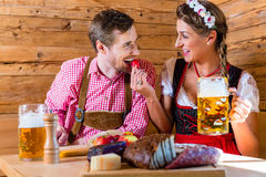 Couple having dinner at mountain hut in alps Stock Image