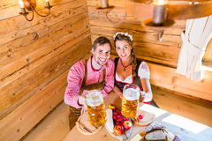 Couple having dinner at mountain hut in alps Stock Photography