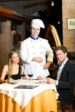 Chef with customers Stock Photography