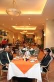 Couple having dinner in restaurant stock photography
