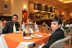 Couple having dinner in restaurant stock photos