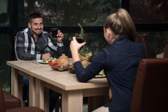 Couple Having Dinner In A Restaurant Stock Photography