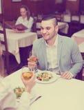 Couple having dinner in restaurant. Smiling young couple having romantic dinner in restaurant stock photo