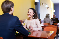 Couple having dinner at restaurant table. Cheerful adult couple having dinner at restaurant table Stock Photos