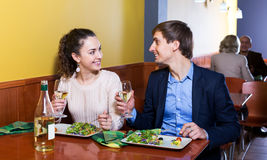 Couple having dinner at restaurant table Stock Images