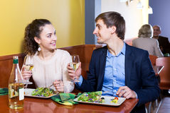 Couple having dinner at restaurant table Royalty Free Stock Images