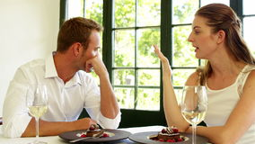 Couple having a disagreement. In a restaurant stock footage
