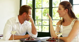 Couple having a disagreement. In a restaurant stock video footage