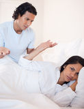 Couple having a dispute in the bedroom Royalty Free Stock Photos