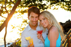 Couple having a drink in the evening Royalty Free Stock Image