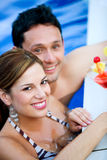 Couple having a drink on vacation Royalty Free Stock Photo