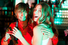 Couple having drinks in bar or club Stock Photos