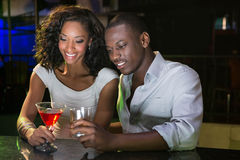 Couple having drinks at bar counter Stock Photography