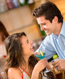 Couple having drinks Stock Photo