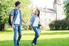 Couple having an enjoyable walk in the garden Royalty Free Stock Image