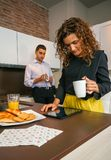 Couple having fast breakfast before go to work Stock Photos