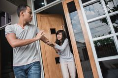 Couple having fight and breakup. Man walking out of door during argument with his woman. couple having fight and breakup concept stock photography
