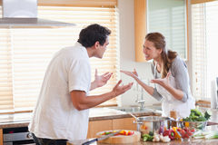 Couple having a fight in the kitchen Royalty Free Stock Photography
