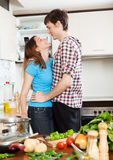 Couple having flirt at  kitchen Stock Images