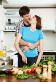 Couple having flirt at  kitchen Royalty Free Stock Image