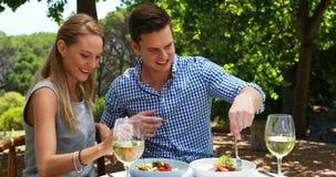 Couple having food in outdoor restaurant 4k stock video footage