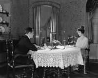 Couple having formal dinner at home stock image