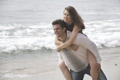 Couple having a fun. Happy young couple having a fun on the beach Stock Photos
