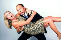 Couple having fun. In studio stock photo