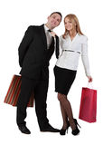 Couple having fun. Image of a young couple with shopping bags having fun while the women pulls her boyfriend tie Stock Image