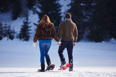 Free Couple Having Fun And Walking In Snow Shoes Stock Photos - 61878693