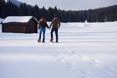Free Couple Having Fun And Walking In Snow Shoes Royalty Free Stock Photo - 62010485