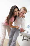 Couple Having Fun In Bathroom Brushing Teeth Stock Photography