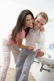 Couple Having Fun In Bathroom Brushing Teeth Stock Photo