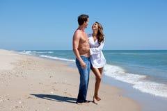 Couple having fun on a beach. Royalty Free Stock Photography