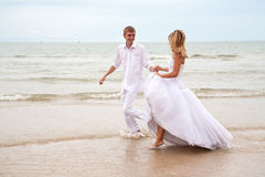 Couple having fun on a beach Royalty Free Stock Photo