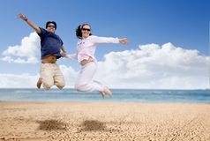 Couple having fun at the beach Stock Images