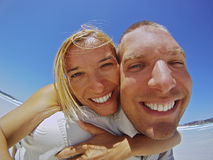 Couple Having Fun On The Beach Royalty Free Stock Photos