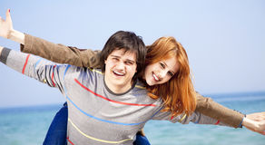 Couple having fun on the beach. Stock Image
