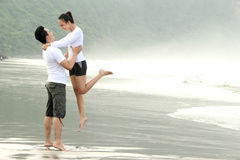 Couple having fun on the beach Stock Photo