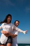 Couple having fun on the beach Stock Image
