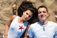 Couple having fun on the beach Royalty Free Stock Photo