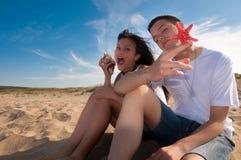 Couple having fun on the beach Royalty Free Stock Photos