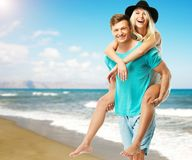 Couple having fun on a beach Royalty Free Stock Image