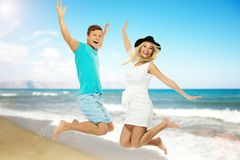 Couple having fun on a beach Stock Photos