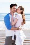 Couple Having Fun On Beach Holiday Stock Photos
