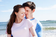 Couple Having Fun On Beach Holiday Stock Photography