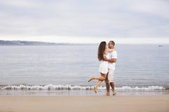 Couple having fun at the beach Royalty Free Stock Image
