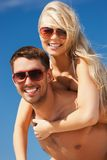 Couple having fun on the beach Stock Photos
